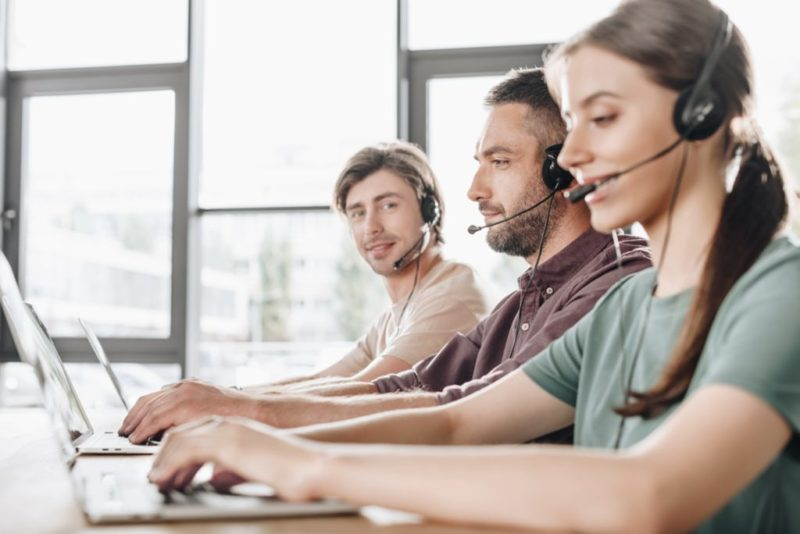 young team of call center managers working together at modern office